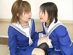 Two Japanese schoolgirls blow multiple dudes and swap cum