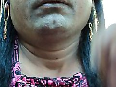 Indian girl shaving her armpits hair by a sharp edged straight razor smooth and clean ..AVI