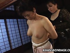 Mature bitch gets roped up and hung in a bdsm session