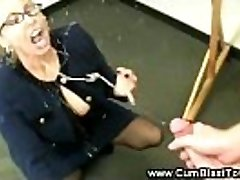 Horny teacher has her students dick in her mature mouth
