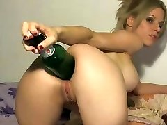 Crazy blonde uses the enormous end of a bottle to stick in her bootie