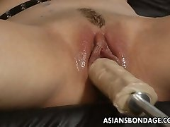 Beautiful blonde bitch dominates the slut with a fuck machin