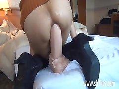 Gigantic anal dildo fucked Asian amateur