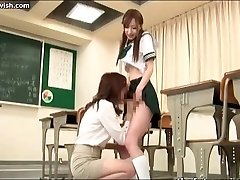 Honey sucks shemale cock in class