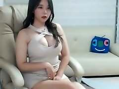 Sexy asian female in pink mini dress