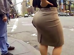 Candid big ass walking in taut work suit