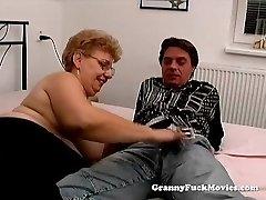 A bulky granny has sex