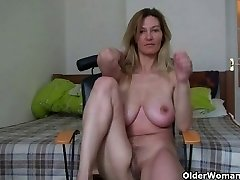 MILF with big boobs rubs her mature cooter