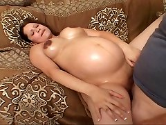 Clean-shaven pregnant bitch drilling for her luck