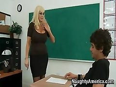 This huge-boobed blondie MILF of a teacher needs some really rough sex