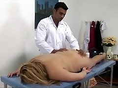Big blonde lady gets pounded on the rubdown table