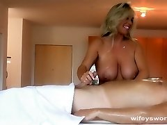 Busty MILF Gives Oil Massage And Hand Job