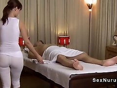 Busty masseuse in undershirt gives rubdown