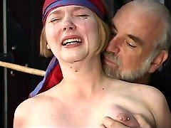 Adorable young towheaded with perky tits is restrained for nipple clamp play