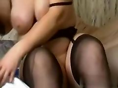i am this naughty slut with huge amateur tits, who is wearing high heels, while fucking a massive dark dildo.