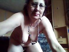 Naughty hairy granny enjoys pissing in the bucket