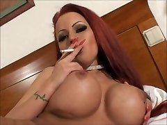 Luxurious xxl tit smoking redhead masturbating