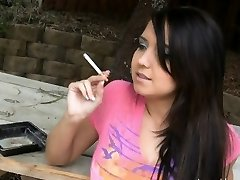 Holding a cigarette and teasing her friend