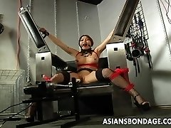 Busty brown-haired getting her raw pussy machine fucked