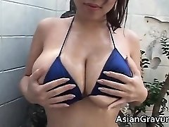 Hot brown-haired asian bitch with big juggs