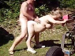 Pummeling mature wife in garden