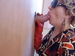 Milf in shoes watches porn and enjoys gloryhole blow-job