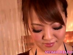 Huge-chested asian milf titfucking