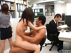 Asian couple romps in the middle of an office