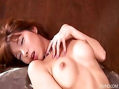 Nasty Serina in candlelight toys her unshaved pussy over and over again