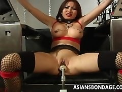 Huge-boobed brunette getting her wet cooch machine fucked