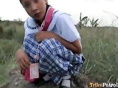 Filipina schoolgirl boinked outdoors in open sphere by tourist