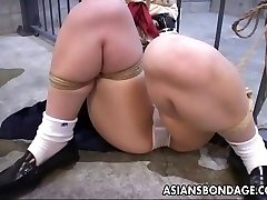 She is trussed up to the prison cell and toy fucked