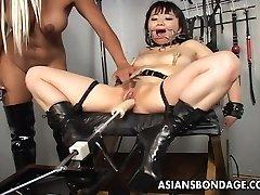 Super-sexy blonde bitch dominates the slut with a fuck machin