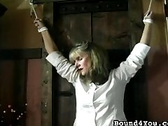 He ties her up in several different positions, taking great pains to get her seurely roped, and lightly whips her pussy with the end of the rope. He seems to take huge pleasure in what he is doing.