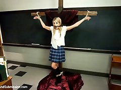Amanda Tate gets in trouble for bullying a classmate and is punished by a strict priest.  She is tied to a cross, her clothes ripped off, flogged and made to come!  Bound in multiple positions, she submits to face fucking and relentless bondage sex!