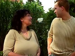 Garden grandmother and younger guy 03