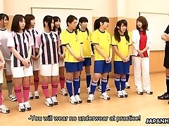 Asian students getting toy drilled during gym