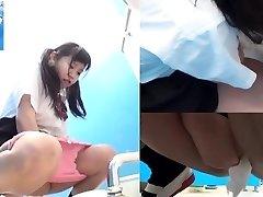 Asian teens pee in toilet