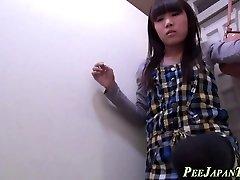 Teenage peeing in toilet