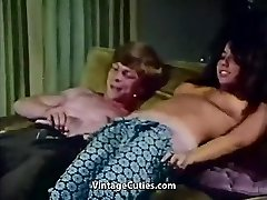 Young Couple Pokes at House Party (1970s Vintage)