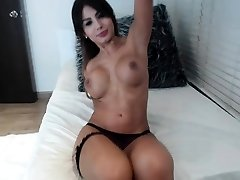 Busty curly brunette with humungous bosoms fucks on couch