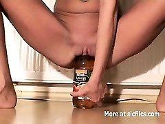 Skinny slut fucking huge bottles