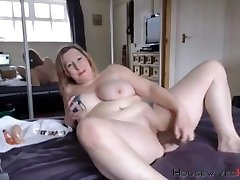 Plumper mature Carmen with huge tattooed tits rides a fake penis