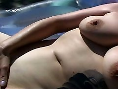 Horny Cougar squirting by the pool