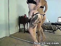 Gothic tattooed platinum-blonde in lingerie is playful