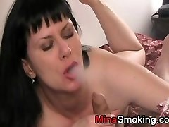 Housewife smoking a cigarette during blowjob