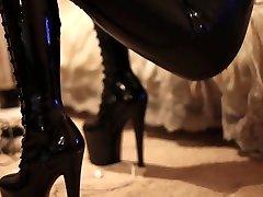 A latex girl ( dark-hued spandex...thigh high pac boots)