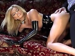Stunning platinum-blonde in dark-hued latex gets deep drilling on a couch