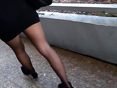 Sheer black pantyhose and short microskirt.