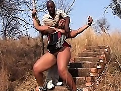 African Nubile Manhandled Bound By Chains Leather